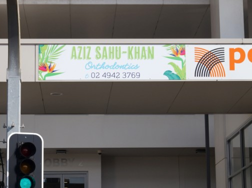 Aziz Sahu Khan Orthodontics sign design